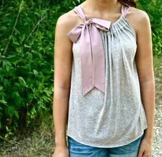 I totally would not do this starting from scratch, BUT take a cool t-shirt or any other shirt from Goodwill, cut off the sleeves, then a quick sew AND voila!  And I could just buy the ribbon!