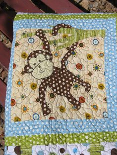 Custom Baby Quilt Jungle Animals Blue Green Chocolate Brown. $195.00, via Etsy.