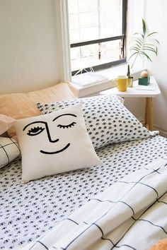 Winky Embroidered Pillow