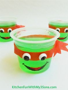 not necessarily cups, but green jello jigglers for sure. maybe half egg shells...turtle shells