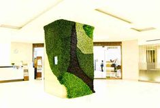 Green Walls and Living Sculpture. Complex and intricate living art arrangements composed of thousands of plants climb the interior walls of of Isetan Shinjuku, one of Japan's oldest department stores.
