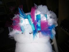 Bow with tulle, ribon,and feathers