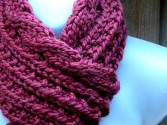 Knitting: Merlot Cable Scrunchable Scarf Cast on a multiple of 3 sts (plus one on each edge for a selvage). The pattern repeat is just K2, P1 - on both sides. Because you are working with an odd number of sts, you get a column of knit sts, a column of purls, and a column of moss st. It pleats itself and its reversible, but its very flexible.