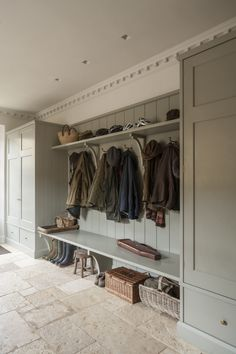 boot room with coats and hats