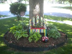 Repurposed garage sale bench planter & and painted lady bug bowling ball