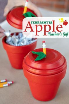 Easy $2 DIY Apple Pot Teacher Gift - I found the perfect DIY teacher's gift — and it'll only cost me $2! Use a terracotta pot to make this homemade candy holder and use free coupons for the candy! Get free coupons and instructions on The Krazy Coupon Lady.