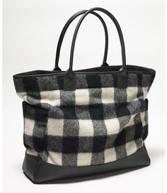 We've employed Maine's most skilled stitchers to handcraft a tote of the highest quality, using bold buffalo-check wool from the famed Woolrich archives trimmed in our exclusive premium leather. A dressed-up version of our iconic open-top tote, with a leather bottom and handles. Two side pockets for easy access to keys, cell phone, water bottle. Interior drop-down pocket holds three additional pockets. Wool is treated for water resistance. Lined in sturdy cotton canvas. Made in Brunswick…