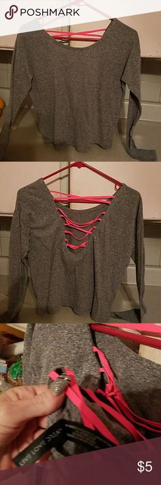 Grey crop top with pink lacings in back. Excellent condition. No flaws. Tied on one strand for extra chic. Live Love Dream Tops Crop Tops