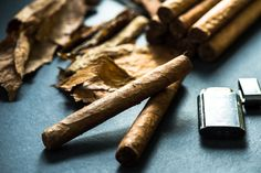 Cuban cigars with leafs and lighter