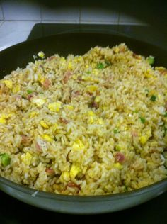 how to make fried rice.... I just made this and is so good... I used 4 eggs, white onion and lunch meat ham and 2 boil a bags wheat rice.... ITS SO GOOD!!