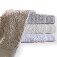 Park Ave Towels by Peacock Alley make a statement with their damask pattern. These velour cotton towels reverse to terry.