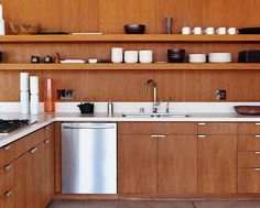 i don't necessarily like the open shelving but i love the simplicity of the cabinet fronts.