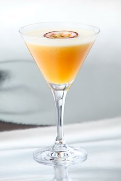 Passion-Fruit-Martini  4 Parts Vodka  1 Part Passionfruit Liqueur  2 Halves Passionfruit