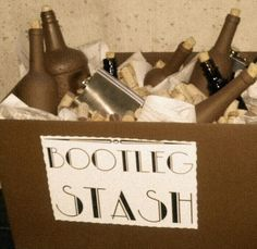 Roaring Twenties Decoration - Bootleg Stash box:  For my sister-in-law's Goodbye to her Roaring Twenties Party. I just sprayed a box matte brown and some bottles. Bottle corks from Joann's (I should have got bigger ones), some old wine corks and newspaper for filling the box!