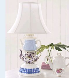 Quaint lamp made of rescued tea pots. Look for tea pots to recycle at Estate ReSale & ReDesign, LLC in Bonita Springs, FL or your local thrift store. Teapot Lamp, Decor, Home Diy, Lamp, Diy Lamp, Table Top Lamps, Diy Tableware, Lights, Home Decor