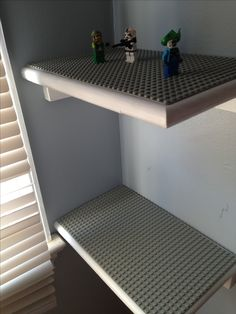 I wanted to do something like corner shelves for lego display but I dont know how to do it for cheap....we have way too many legoes!