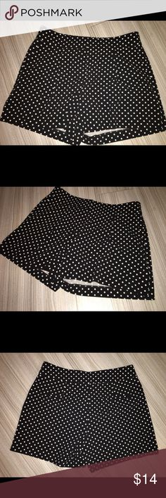 """Ann taylor black & white shorts Sz: 0 Thank you for viewing my listing, for sale is a pair of women's, Ann Taylor brand, black shorts with white polkadot, size 0  Great condition no rips or stains  If you have any questions or would like additional photos please feel free to ask.  Outseam measures appx 14"""" inseams measures appx 5"""" Ann Taylor Shorts"""
