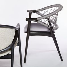 The Umami armchair with Trieste rope back features a backrest made from two curving bentwood beech pieces that combine with four legs to create a sleek and slender frame. The upholstered seat is comfortable, the rope back intriguing. The rope is woven by hand, adding an artisanal element into the mix and when paired with the light frame, makes for a truly striking rope chair. Contemporary Dining Chairs, Fabric Suppliers, Trieste, Cribs, Armchair, Legs, Frame, Furniture, Home Decor