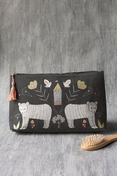 Wild Tale Large Cosmetic Bag - A large cosmetic bag made from 100% linen and with a vegan leather lining is perfect for storing your beauty essentials, accessories, toiletries and more. Enchanting animals and foliage are arranged in harmonious symmetry with golden metallic highlights against an unbleached background. A pastel peach tassel adds a textured detail. Large Cosmetic Bag, To My Mother, Travel Toiletries, Cat Design, Beauty Essentials, Large Bags, Zipper Pouch, Bag Making, Vegan Leather