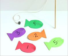Make your very own fishing math game using magnets and foam fish. The post also includes a two free printables for addition and 1:1 correspondence practice.