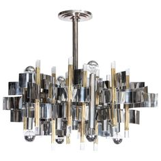 Gaetano Sciolari two tone twelve light Mid-century Modern chandelier | From a unique collection of antique and modern chandeliers and pendants  at http://www.1stdibs.com/furniture/lighting/chandeliers-pendant-lights/