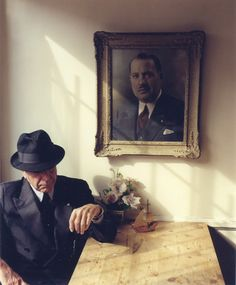 Leonard Cohen beneath a portrait of his father, Nathan Cohen | Tina Tyrell