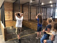 What is axe throwing? It's the best way to connect with your inner lumberjack! This fun new activity involves throwing an axe at a target to score points. Lumberjack Games, Lumberjack Competition, Bodega Bar, Knife Throwing, Timberwolf, Christmas Tree Lots, Fencing Material, Outdoor Store, Shooting Range