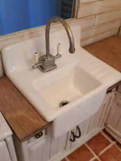 how to: I made the sink with wood and used the same paint that I used on the stove (with the triple thick glaze) The drain is a little grommet, and the faucet is m...