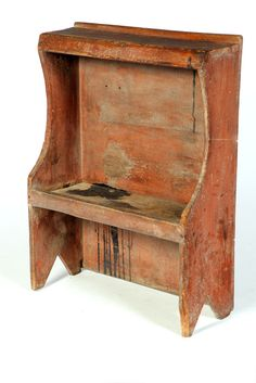 American, early 19th century, pine, two-tier stand with cutout sides and ends with enclosed top, pegged and rosehead nail construction, old dry red painted surface, 36 H. x 27 W. x 11 D.