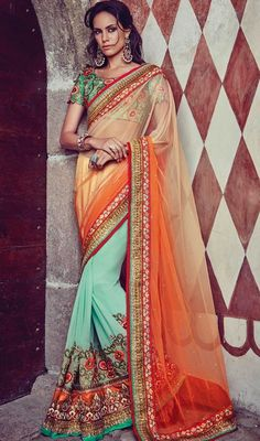 Create a lasting impact on the onlookers in this green and orange color georgette chiffon net half n half sari. Beautified with lace, resham and stones work.  #floralembroideredsaree #nethalfnhalfsarees #latestdesignsareescollection