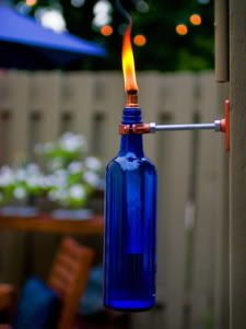 If you have a few beautiful (wine) glass bottles, you can turn them into cool torches for your garden. Keep in mind:  Care and caution is necessary when using these since it's an open flame, never leave a lit torch unattended