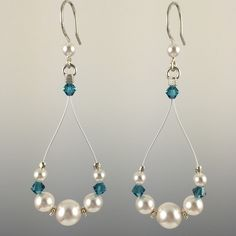 - Swarovski crystals and Swarovski crystal pearls - Hand formed Sterling silver earwires with rubber earring backers - Beads are strung on a colored, stainless steel nylon coated cable for durability