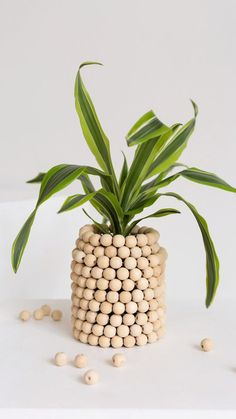Do it yourself - Beaded Wood Planter: This week, we have an easy wood DIY for you! This beaded wood planter is a great idea if you are looking for a unique DIY pot. summer crafts for adults room decor Übertopf DIY Do It Yourself Videos, Fleurs Diy, Wood Planters, Garden Planters, Cheap Planters, Tall Planters, Modern Planters, Indoor Planters, Ceramic Planters