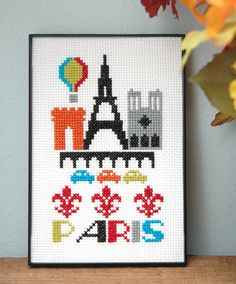 Make a Paris city scene with the Eiffel Tower, Arc de Triumphe, Notre Dame cathedral, hot air balloon, and 3 fleur de lis on 14-count Aida cloth.  This pattern