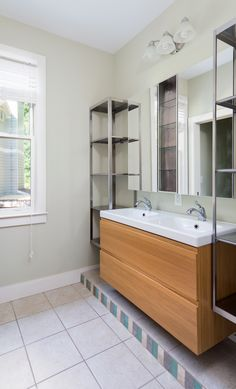 Bathroom with tons of storage from IKEA, mosaic tile, ceramic tile