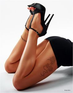 Nothing beats a good pair of legs in heels ... The tat is sweet too :)