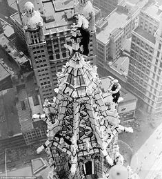 Head for heights: Steeplejacks working on the top of the Woolworth building in New York