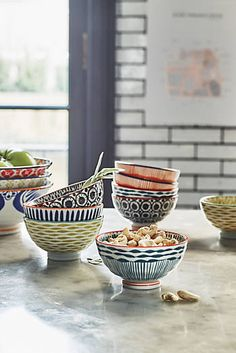 Beautiful painted serving pieces add color and interest to your dining table. #anthro