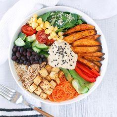 Vegan buddha bowl with tofu, brown rice, baked sweet potato, spinach, cucumber, corn, cherry tomatoes, black beans, sesame soy enoki mushrooms, hummus and bell pepper. Photo by Cherie @thrivingonplants #hummus #tofu #buddhabowl - - - - - - - - - - - - - - - - - - - - - - - #vegan #veganbowl #macrobowl #spinach #veggies #eatyourveggies #bellpepper #cherrytomatoes #tofusalad #rawfood #rawvegan #hummuslove #soy #mushrooms #veganfoodshare #mushroom #bigsalad #healthyfood #bestofvegan…