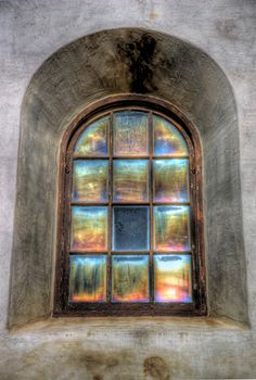 Old window with rainbow effects at the Junipero Serra Museum in San Diego California. By Paul Koester.