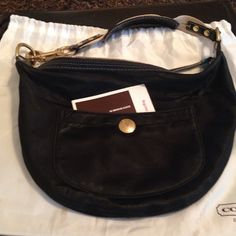 Authentic Coach bag Black Coach bag. Good condition some signs of wear as seen in close up picture of a spot. Original dust bag and care card included Coach Bags