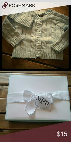 Mudpie Cardigan with matching hat Baby blue cable knit cardigan with matching hat comes packaged in a nice gift box with bow. NWT from my children's boutique Mud Pie Matching Sets