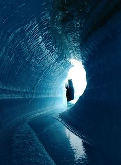Glacial TunnelAn ice cave or englacial melt channel. This ice cave was formed by meltwater flowing within the glacier ice. Belcher Glacier, Devon Island, Nunavut, Canada. - Credit: Alex Gardner