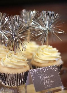 Sparkling vanilla cupcakes with a tinsel topper - These are easy to make & will look great at any celebration...x