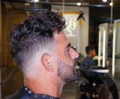 edgy disheveled curly hairstyles for men