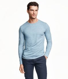Long-sleeved T-shirt in stretch jersey with a round neckline.