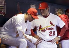 Manager Mike Matheny talks with starting pitcher Adam Wainwright during the 6th inning  9-28-12