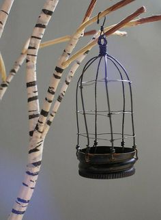 birdcage made of a bottle cap... love the wrapped birch branch as well...