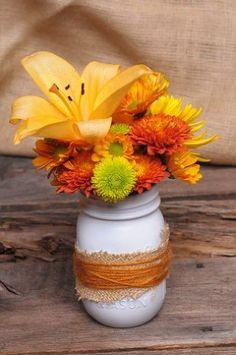 budget friendly fall decor, christmas decorations, crafts, mason jars, outdoor living, seasonal holiday d cor, wreaths, Everyone has mason jars burlap and spray paint laying around now a days Might as well combine them with the colorful flowers in the garden for fall inspired centerpieces when guests are coming by