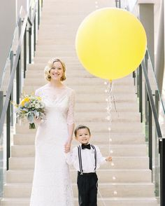 "We ♥ this! The bride chose to have her ring-bearer nephew carry a balloon painted with the words ""Here Comes the Bride"" for the ceremony."